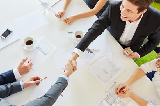 Business people handshake as sign of partnership