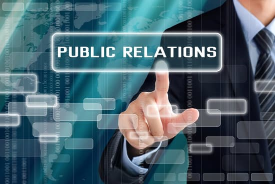 Businessman hand touching PUBLIC RELATION sign on virtual screen