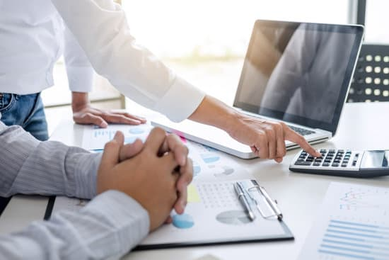 Business accountant banking, business partner offering calculate and analysis with stock financial indices and financial costs wisely and carefully, investment and finance concept.