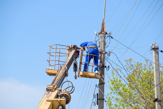 Electricians repair the power line. Workers are locksmith electricians.