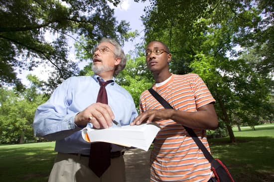 Professor and student outdoors