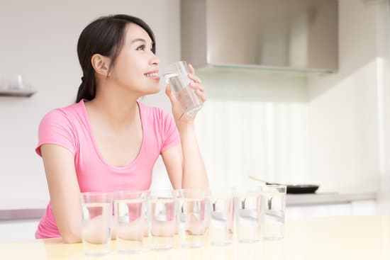 woman drink water with health concept in the kitchen
