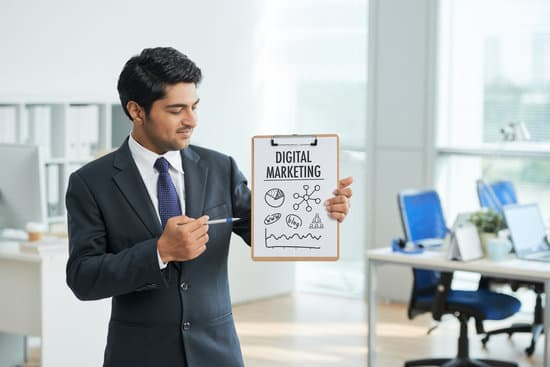 Young businessman presenting new marketing plan at office