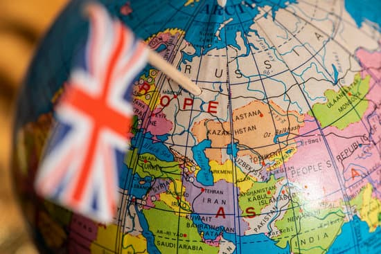 UK concept targeting Russia. British flag pricked on Russia on globe. The United Kingdom focused on Russia on the map.