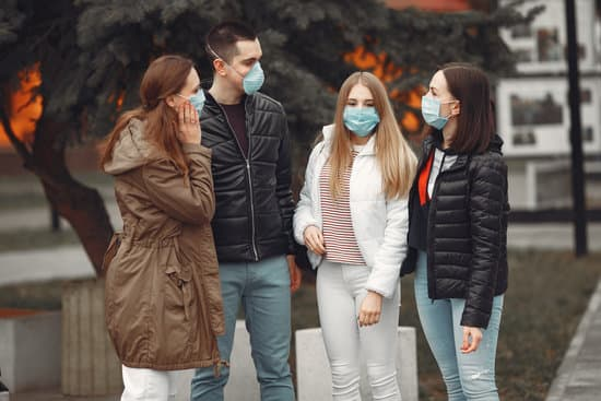 Young people are spreading disposable masks outside. The man and women are discussing virus problem.