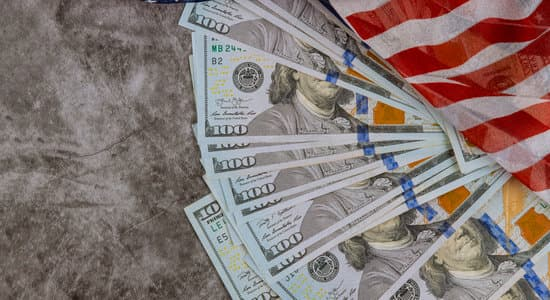 USA economic top view american flag on US dollars background