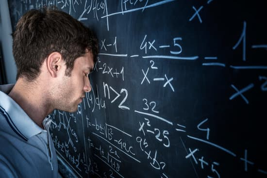 stressed student pose his head on chalkboard