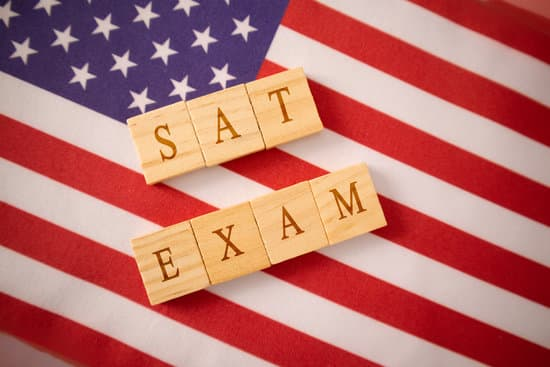 SAT Exam in Wooden block letters on US flag.