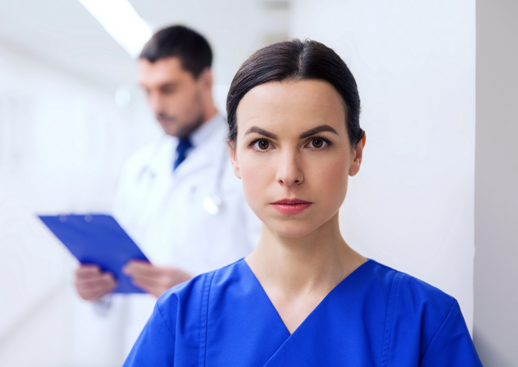 healthcare, profession, people and medicine concept - doctor or nurse at hospital corridor, Ultimate Guide to Nursing featured