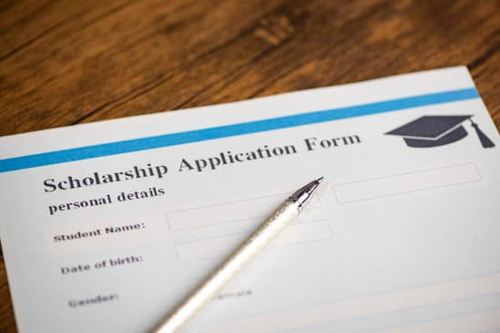 Scholarship application form document contract concept with pen for grants education on wooden table
