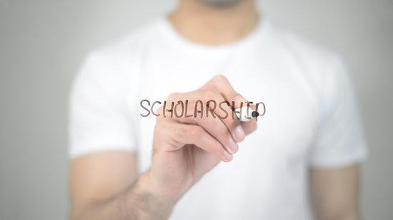 Scholarship, man writing on transparent screen