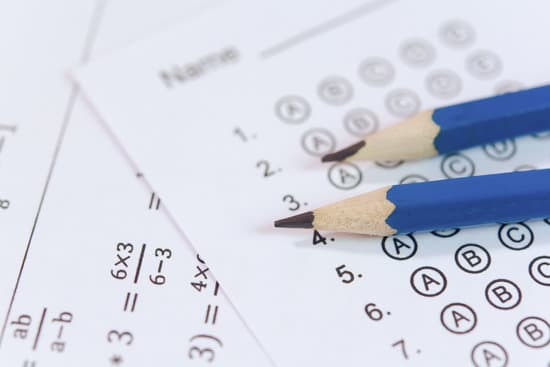 Pencil on answer sheets or Standardized test form with answers bubbled. multiple choice answer sheet