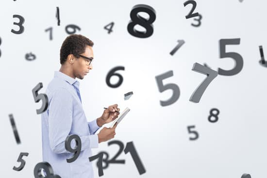 Side view of serious young African American college student in glasses taking notes standing over white background with falling numbers. Concept of education and science.