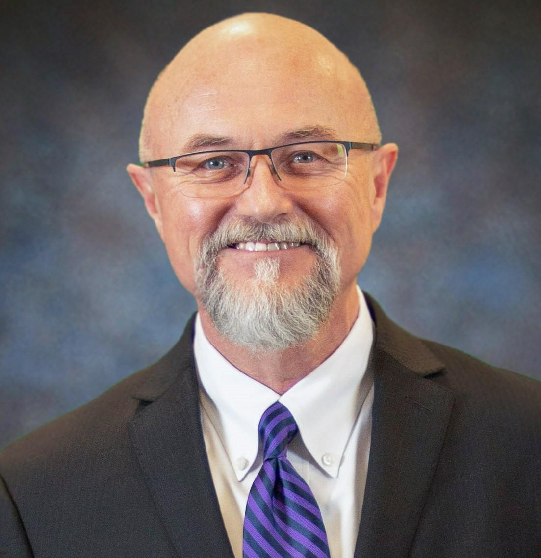 Dr. Ric Neal Baser